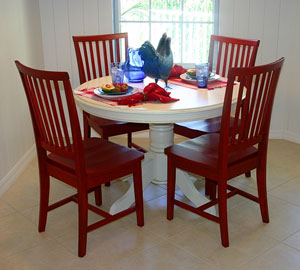 white kitchen table and four wooden chairs
